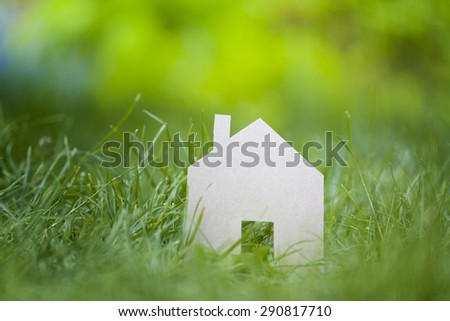 house sign against green field
