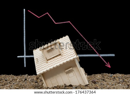 house sinking with a downward arrow on background, financial concept - stock photo
