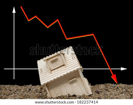 house sinking with a downward arrow on background, horizontal, financial concept - stock photo