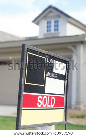 House sold sign on sign board outside home - stock photo