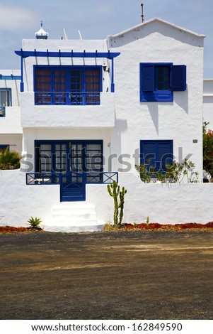 house step cactus bush  rock stone sky in arrecife lanzarote spain  - stock photo