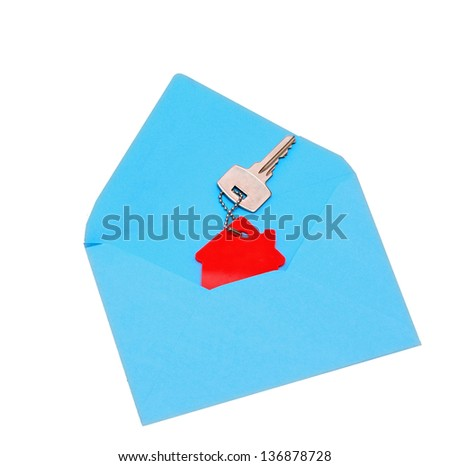 house symbol and key in open envelope - stock photo