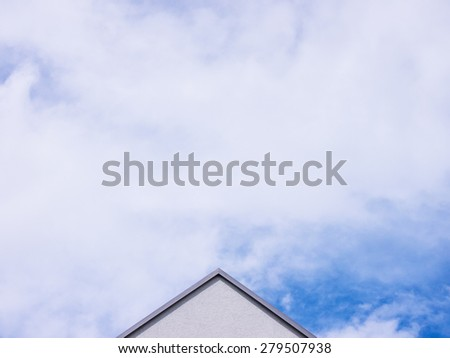 house top and sky with clouds - stock photo