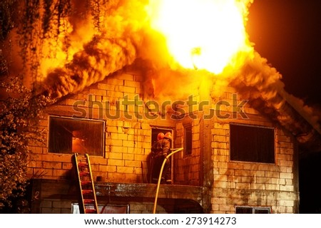 House under construction caught fire by night