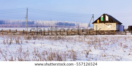 House under construction on the edge of the village.Winter landscape.