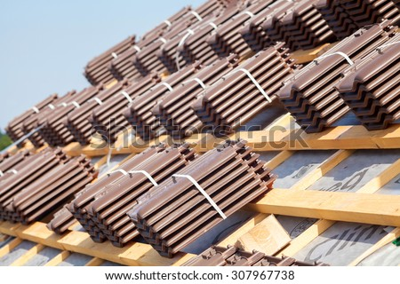 House under construction. Roofing tiles preparing to Install - stock photo