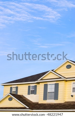 House under the blue sky - stock photo