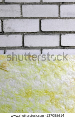 house wall insulation with rock wool - stock photo