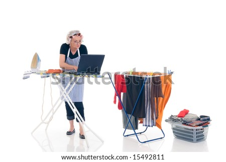 House wife, basket with ironed goods, clothes line with washed clothing, daily household, chatting on laptop.