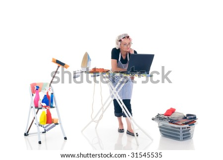 House wife, basket with ironed goods, ladder with cleaning products, daily household, chatting on laptop.