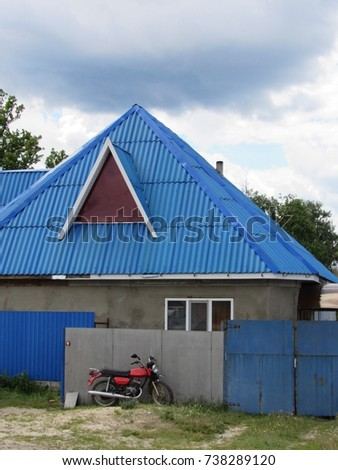 house with a blue roof
