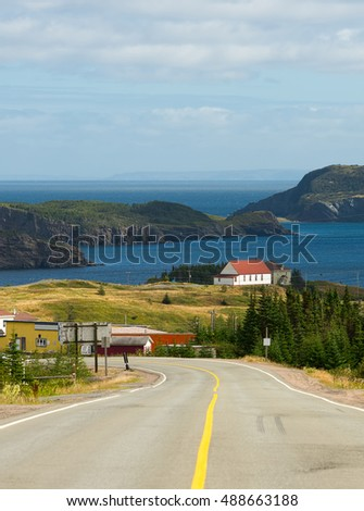 House with a red roof at the coast in Newfoundland