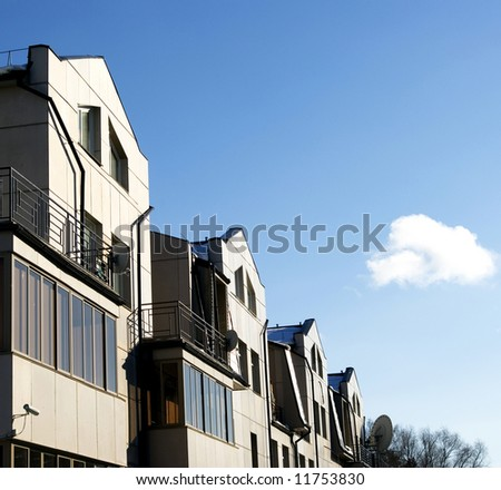 House with a roofline on the blue sky background