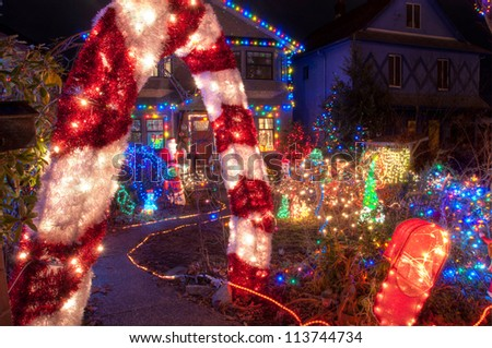 House with entire front yard covered in colorful Christmas lights.