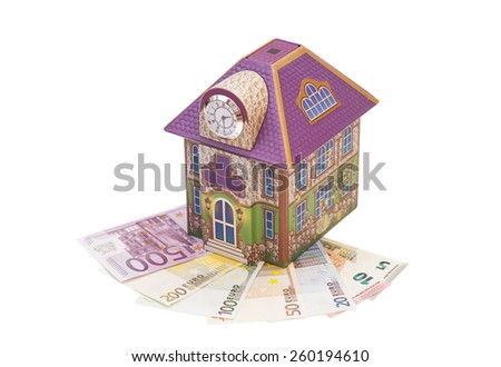House with euro notes isolated - stock photo