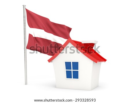 House with flag of latvia isolated on white