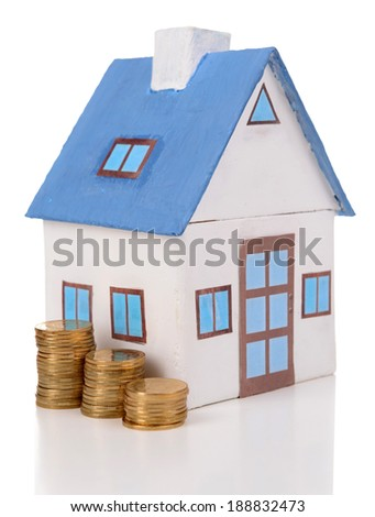 House with heap of coins isolated on white