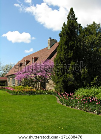 House with landscape in full bloom in spring - stock photo