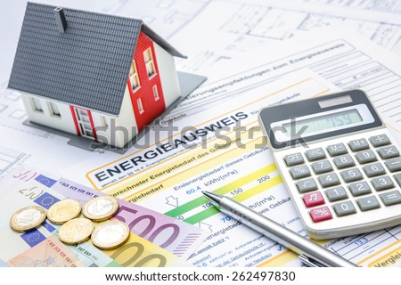 House with money and calculator. Mortgage calculation - stock photo