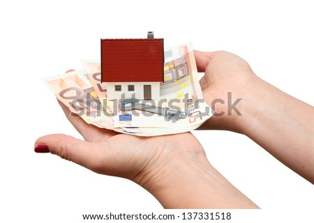 House with money and key isolated over white - stock photo