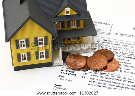 House with money and tax paper – mortgage deduction - stock photo