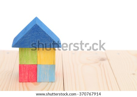 house with natural colored toy blocks - stock photo