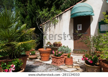 house with plants in south of France - stock photo