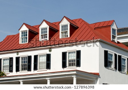 House with red roof and dormer windows - stock photo