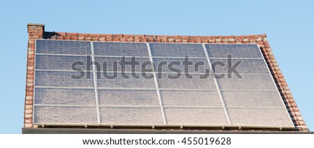 house with solar panels and dust on solar panels