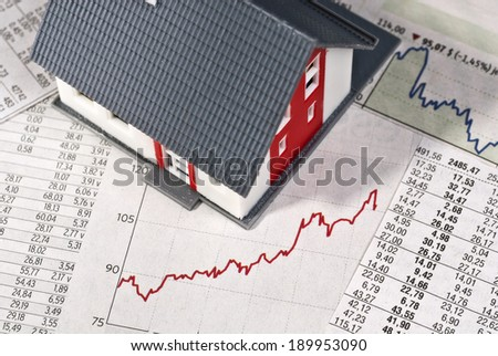 House with tables and graph - stock photo