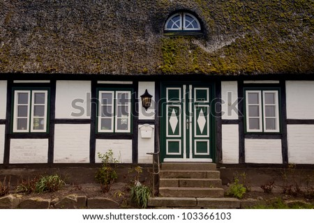 House with thatched roof in the village Sieseby in Schleswig-Holstein, Germany