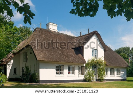 House with thatched roof on the island Sylt, Germany - stock photo
