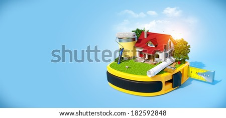 House with the yard and construction equipment on a tape measure. Construction concept - stock photo