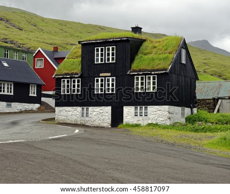 House with turf roof on the Faroe island of Eysturoy, which is located midway between Iceland and Northwest Scotland, United Kingdom