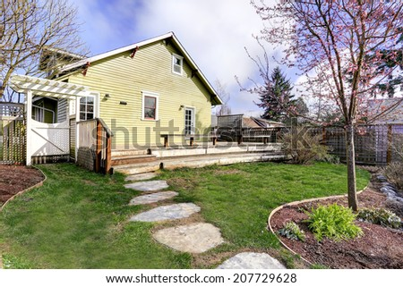 House with walkout deck and small garden. Early spring