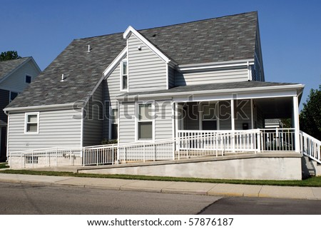 House with Wheelchair Ramp - stock photo