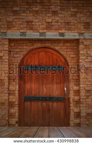 House wooden door  with a  brick wall and wooden floor - stock photo