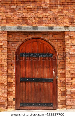 House wooden door  with a  brick wall building - stock photo