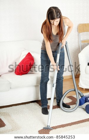 House work,young beautiful woman with vacuum cleanerat home. Housework concept - stock photo