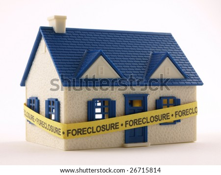 House wrapped with Foreclosure tape front view - stock photo