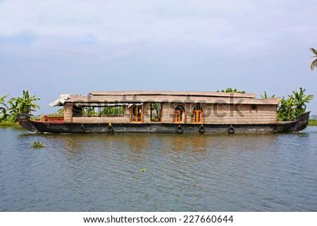 Houseboat in backwater of Kerala  - stock photo