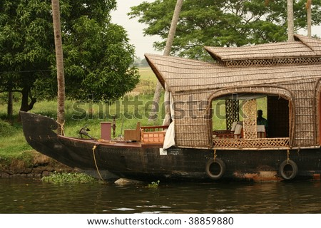 houseboat in kerala backwaters, india - stock photo