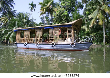 houseboat in the backwaters of kerala - stock photo