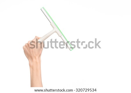 Household cleaning and washing windows theme: man's hand holding a green scraper windows isolated on a white background in the studio. - stock photo