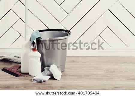 Household. Cleaning tools on the floor - stock photo