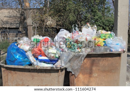 household waste in old metal recycle bins. photos - stock photo
