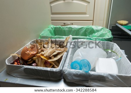 Household waste sorting and recycling kitchen bins in the drawer. Environmentally responsible behavior concept, ecology concept. - stock photo