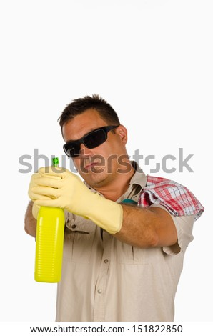 Househusband playing James bond with his cleaning products - stock photo