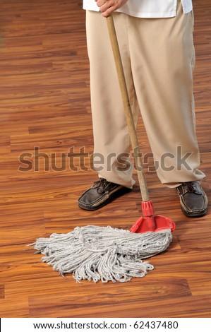 Young Housekeeper Mobbing Floor Series Hotel Stock Photo