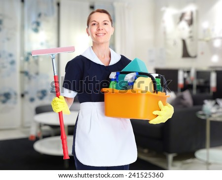Housemaid cleaner woman working in modern hotel - stock photo